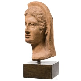 An impressive Fragment of an Italian-Etruscan votive head, 4th - 2nd century B.C.