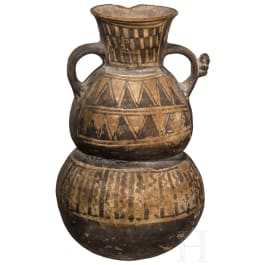 A Peruvian clay vessel, Peru, circa 1000 A.D.