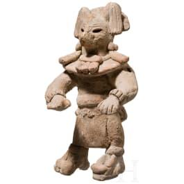 A rare Mexican terracotta figure with a coyote mask, Veracruz, circa 900 - 1200 A.D.
