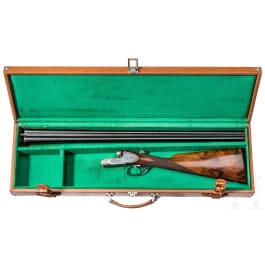 A side-by-side shotgun, in case, Belgium