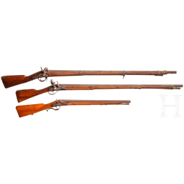 An infantry musket M 1854 and two foreign guns