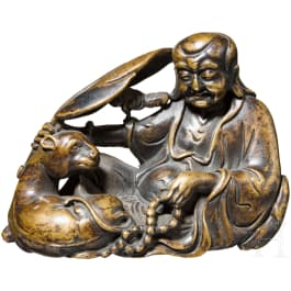A small China bronze of a resting wise man, 18th/19th century