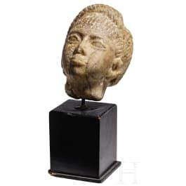 An Egyptian alabaster head, 2nd - 1st millennium B.C.