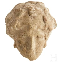 A Greek-Hellenistic terracotta head of Heracles, 3rd - 2nd century B.C.
