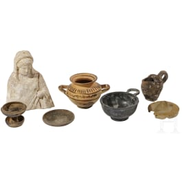 Four Lower Italian miniature vessels, a votive figure and two lids, 4th - 3rd century B.C.