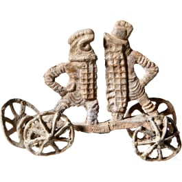 A Roman minature votive wagon with two fighting gladiators, 1st - 2nd century A.D.