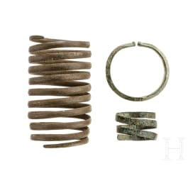 A Central European arm spiral, a bracelet and a hairband, Bronze Age, 1500 - 800 B.C.