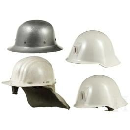Four helmets Civil Defence/THW, FRG, GDR, 1970s - 1980s