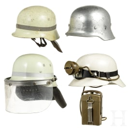 Four helmets of the fire brigade and THW, 1950s - 1990s