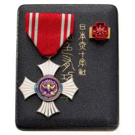 A Japanese Red Cross silver medal for women in box