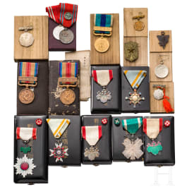 A group of 17 Japanese awards and medals with cases, Meiji and Showa period