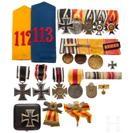 A small military medal estate with two medal bars, an Iron Cross 1st class in box and other badges