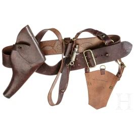 A holster, belt, shoulder strap, sabre bag and a whistle for a Webley revolver