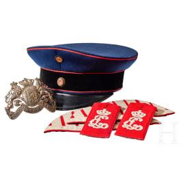 A visor cap and assorted insignia