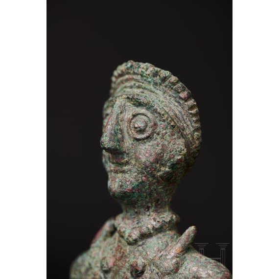 A superb Elamite bronze statuette of a priestess, Near East, 3rd millennium B.C.