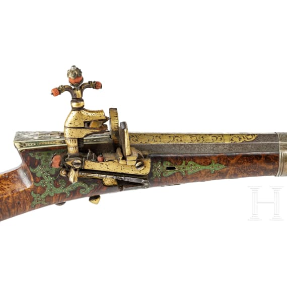 An Ottoman gold-inlaid miquelet-lock rifle (Tüfek) adorned with corals, mid-18th century