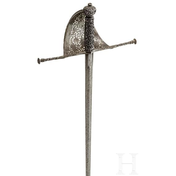 An Italian left-hand dagger with fine openwork hilt, circa 1650