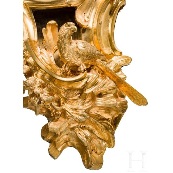 A fire-gilt Louis XV cartel clock, Dupont of Paris, mid-18th century