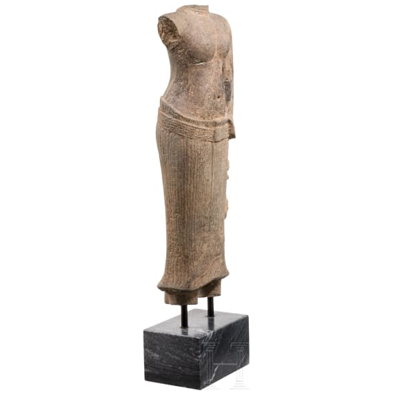 A Khmer stone figure of a female goddess (Uma), Angkor Vat style, circa 11th century