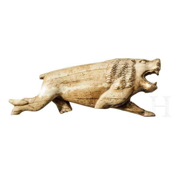 A large presumably Near Eastern ivory lion, circa 1000 - 500 B.C.