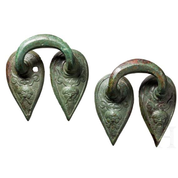 Two late archaic Greek handles, bronze, circa 500 B.C.