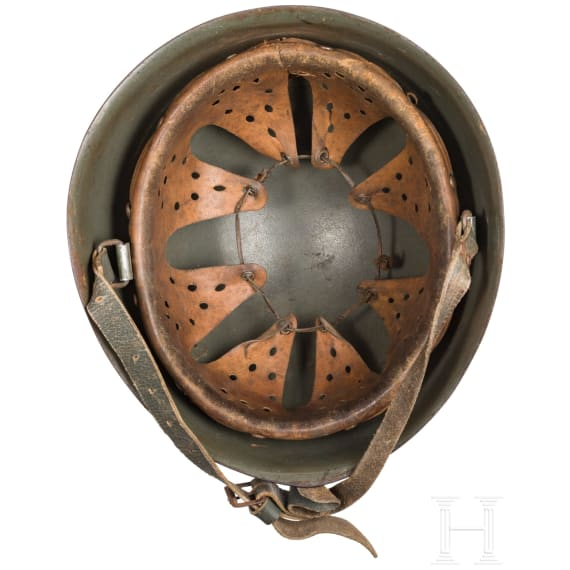 A steel helmet M 34 in tropical camouflage