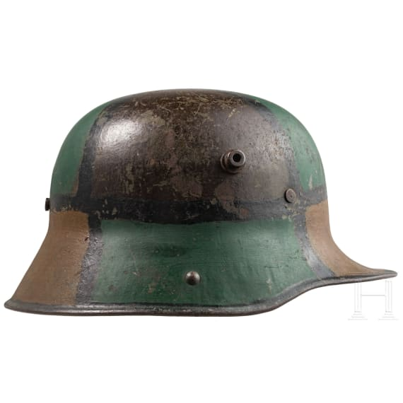 A steel helmet M 16 with mimicry paint