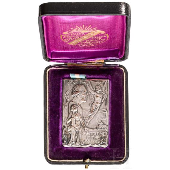 Argentina - a cased commemorative badge for Bartolome Mitre 1906