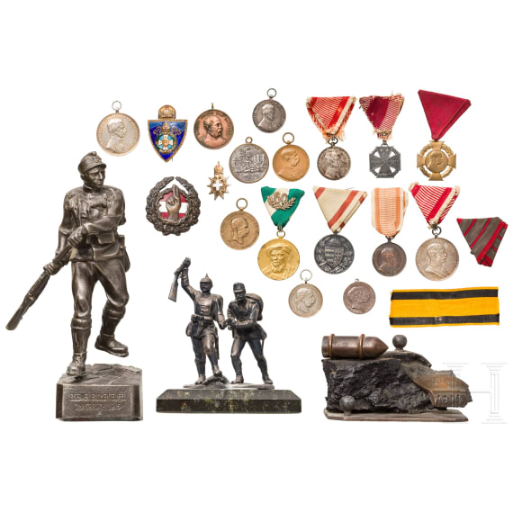 A small group of Austrian militaria and badges