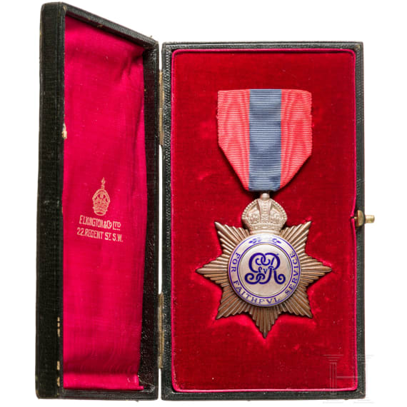 Great Britain - an Imperial Service Medal with document, dated 1913