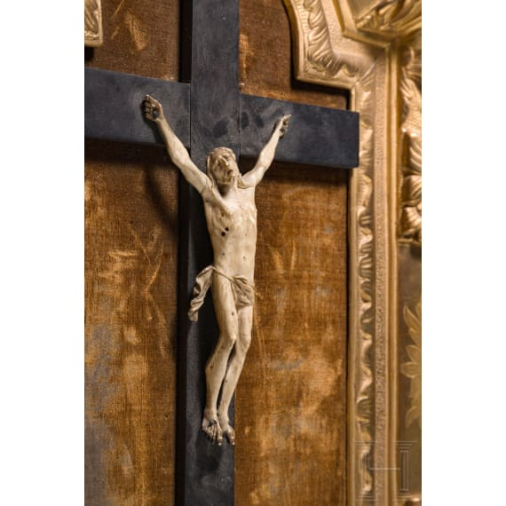 A fine Italian carved body of Christ in baroque frame, 18th century