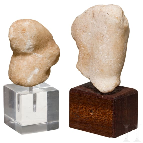 A Roman miniature torso of Venus and a hand fragment, marble, 1st century