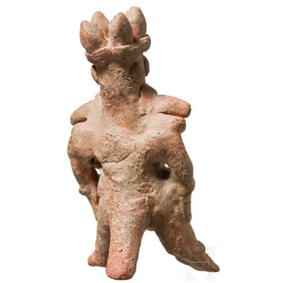 A Mexican terracotta figure with bird mask, Veracruz, 7th - 9th century