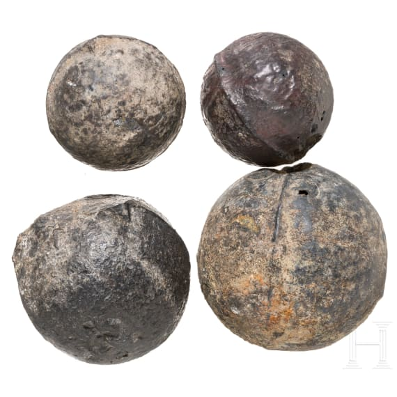 Four German cast iron cannon balls, 16th century