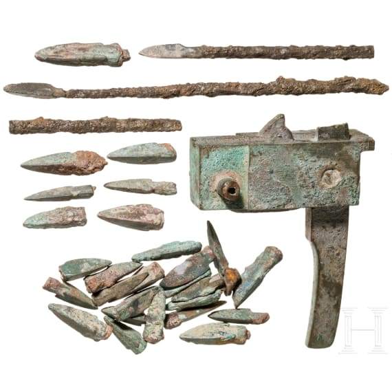 A Chinese crossbow lock and a lot of 29 arrow heads, Han dynasty, 206 B.C. – 220 A.D.