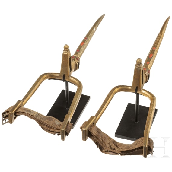 A pair of Algerian fire-gilt and coral-set spurs, 18th century