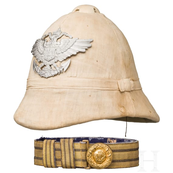 A pith helmet for members of the Imperial Navy and the protection forces in the colonies, circa 1900, and a belt buckle for a military doctor