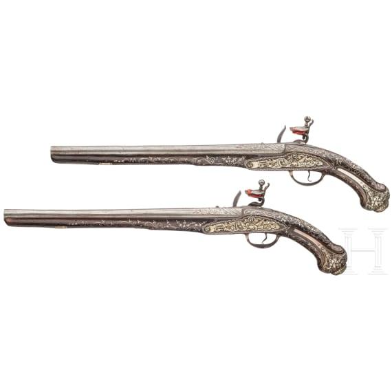 A pair of Ottoman silver-mounted oriental flintlock pistols, circa 1820/30