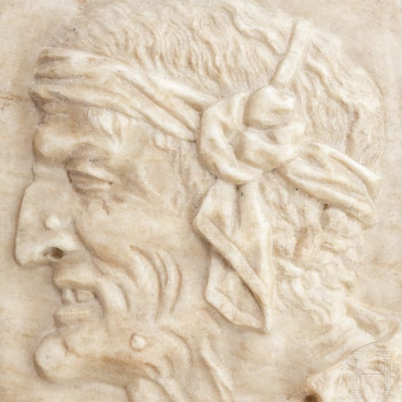 A Venetian portrait relief of a pirate in marble, 16th/17th century