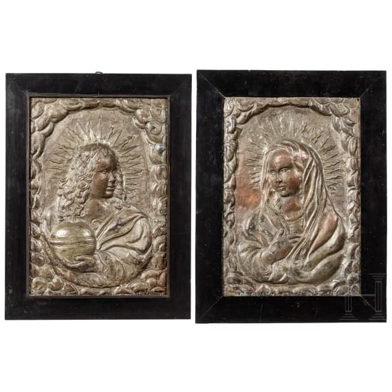 A pair of South German silvered metal panels showing Jesus and Mary, circa 1700