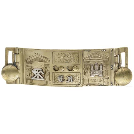 A Swabian carpenter's brass belt buckle, dated 1822