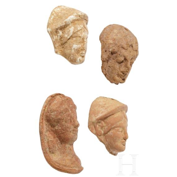 Four Greek votive heads, terracotta, 4th - 2nd century B.C.