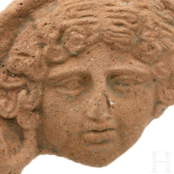 A Greek terracotta antefix with gorgoneion, 3rd - 2nd century B.C.