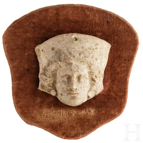 A Greek-Hellenistic terracotta head of Medusa(?), 3rd - 2nd century B.C.