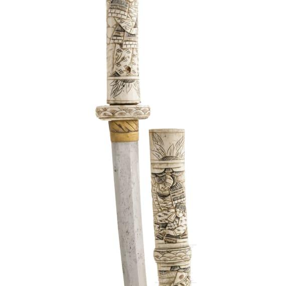 A Japanese whale-bone mounted katana with a blade of circa 1450