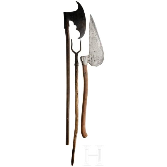 A carpenter's axe and the replica of a war axe, 19th century