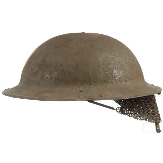 A British steel helmet Mk I with chain mail visor, circa 1917