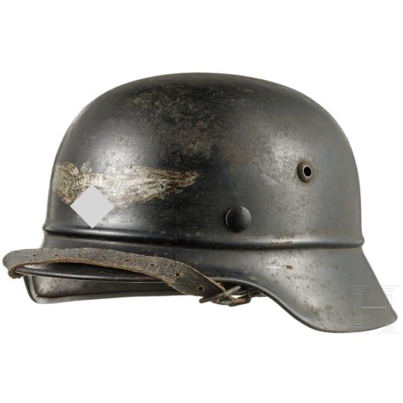 A steel helmet M 35 for air-raid protection, circa 1939