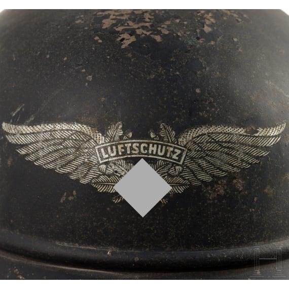 "A German steel helmet ""Gladiator"" for air-raid protection, circa 1940"