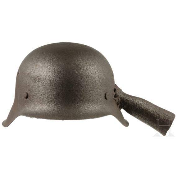 A German steel helmet M 42, reworked to a trowel, 1945/46